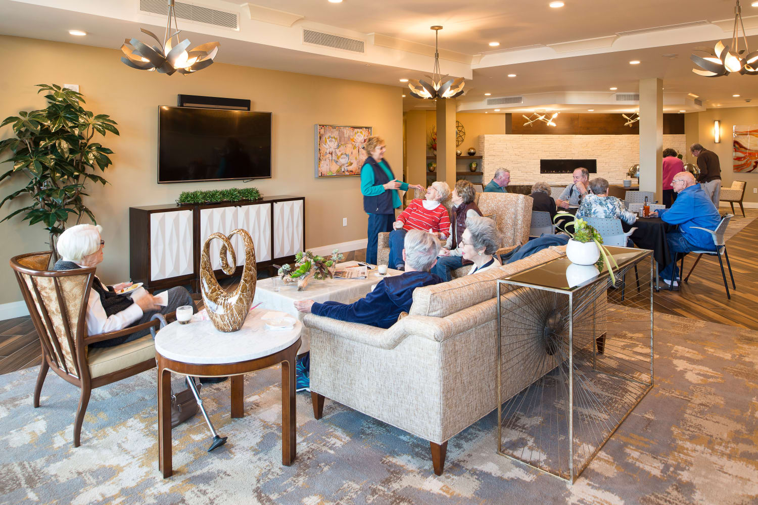 Residents conversing in one of the many gorgeous and comfortable common areas at Village at Belmar