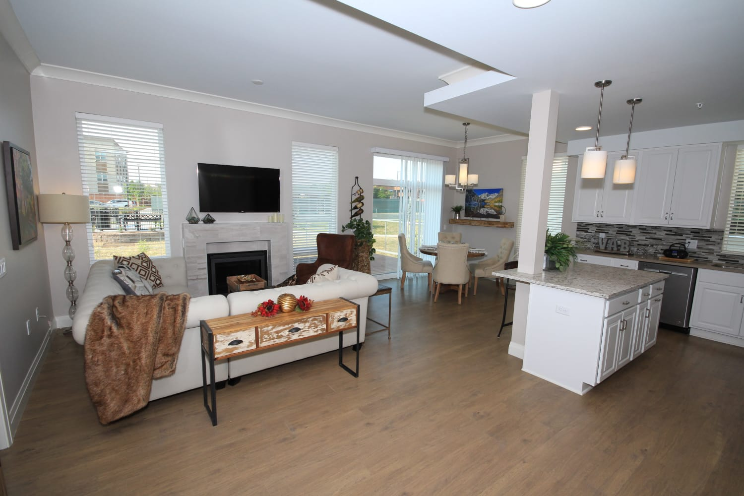Interior view of the living room of one of the spacious independent living homes at Village at Belmar