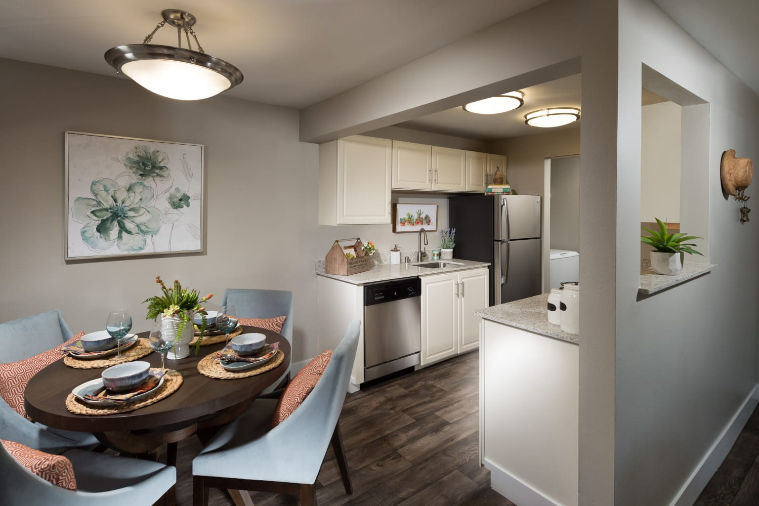Bright dining room and kitchen at Campbell Run Apartments in Woodinville, Washington
