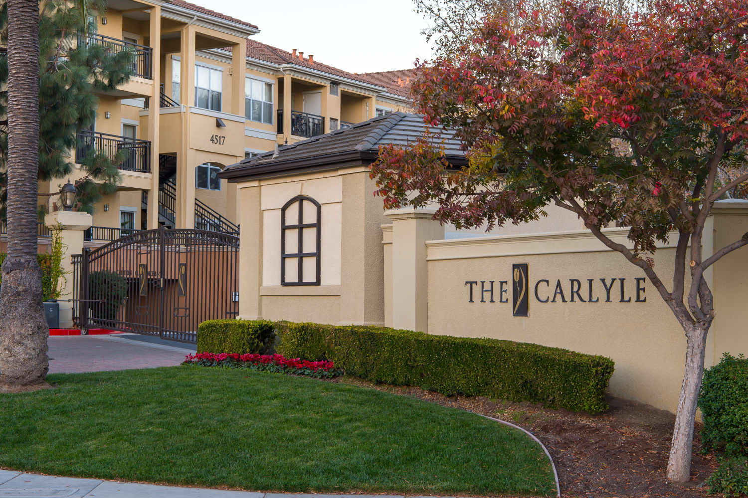 Beautifully landscaped front entrance at The Carlyle in Santa Clara, California