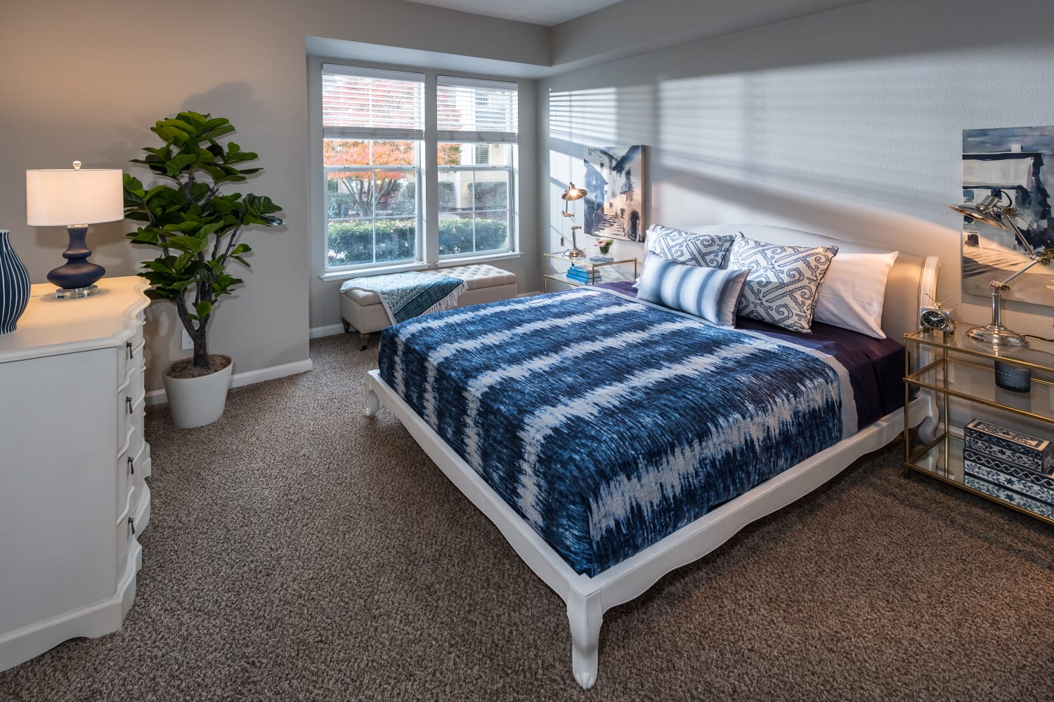 Sun-lit bedroom at Nantucket Apartments in Santa Clara, California