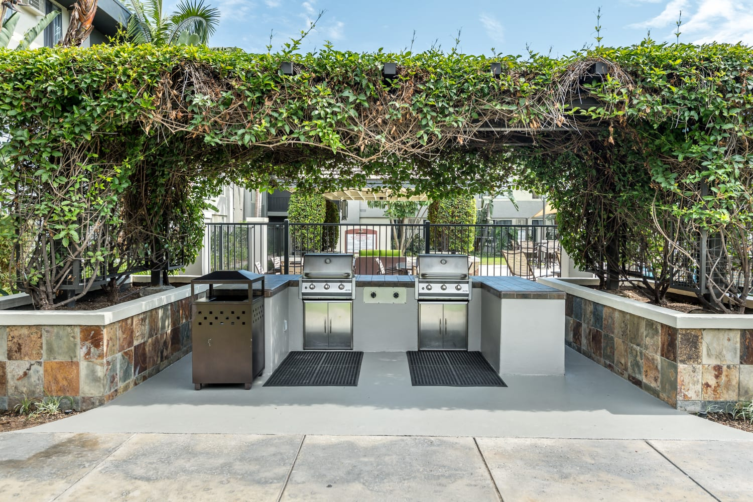 UCE Apartment Homes in Fullerton, California, offers an outdoor barbecue area