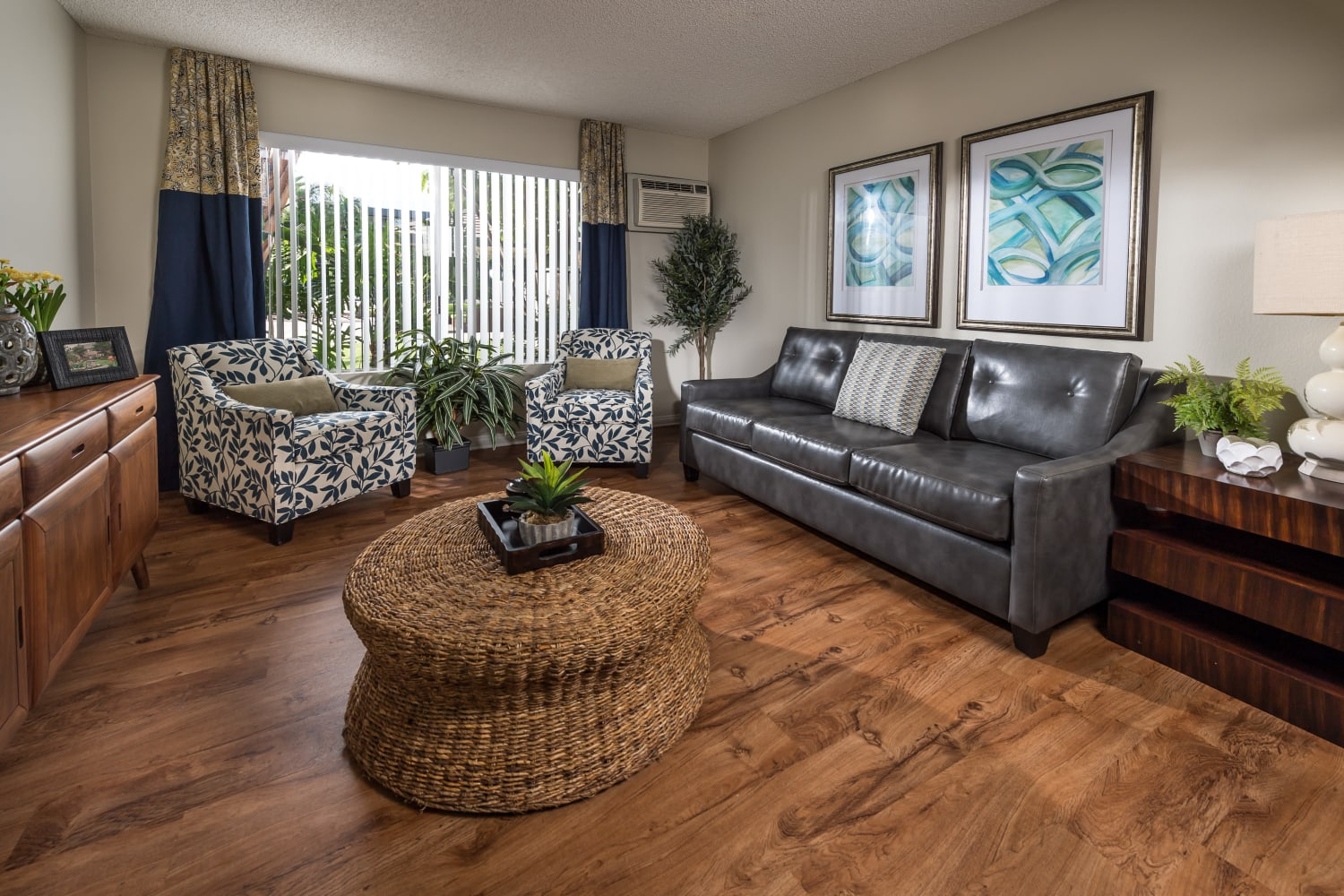 UCE Apartment Homes in Fullerton, California, offers open living room floor plans with hardwood floors