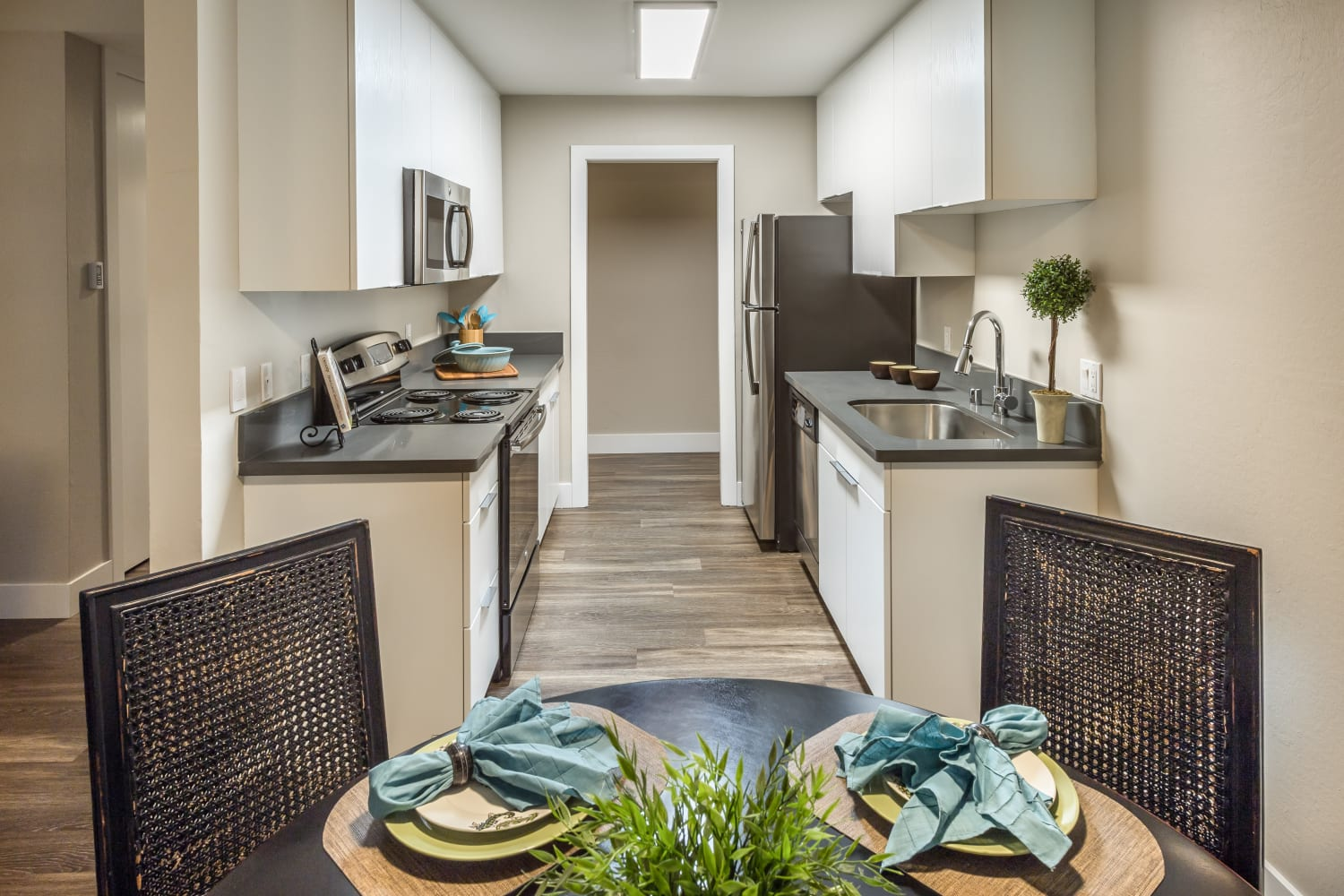Well-appointed dining room and kitchen at Harbor Cove Apartments in Foster City, California