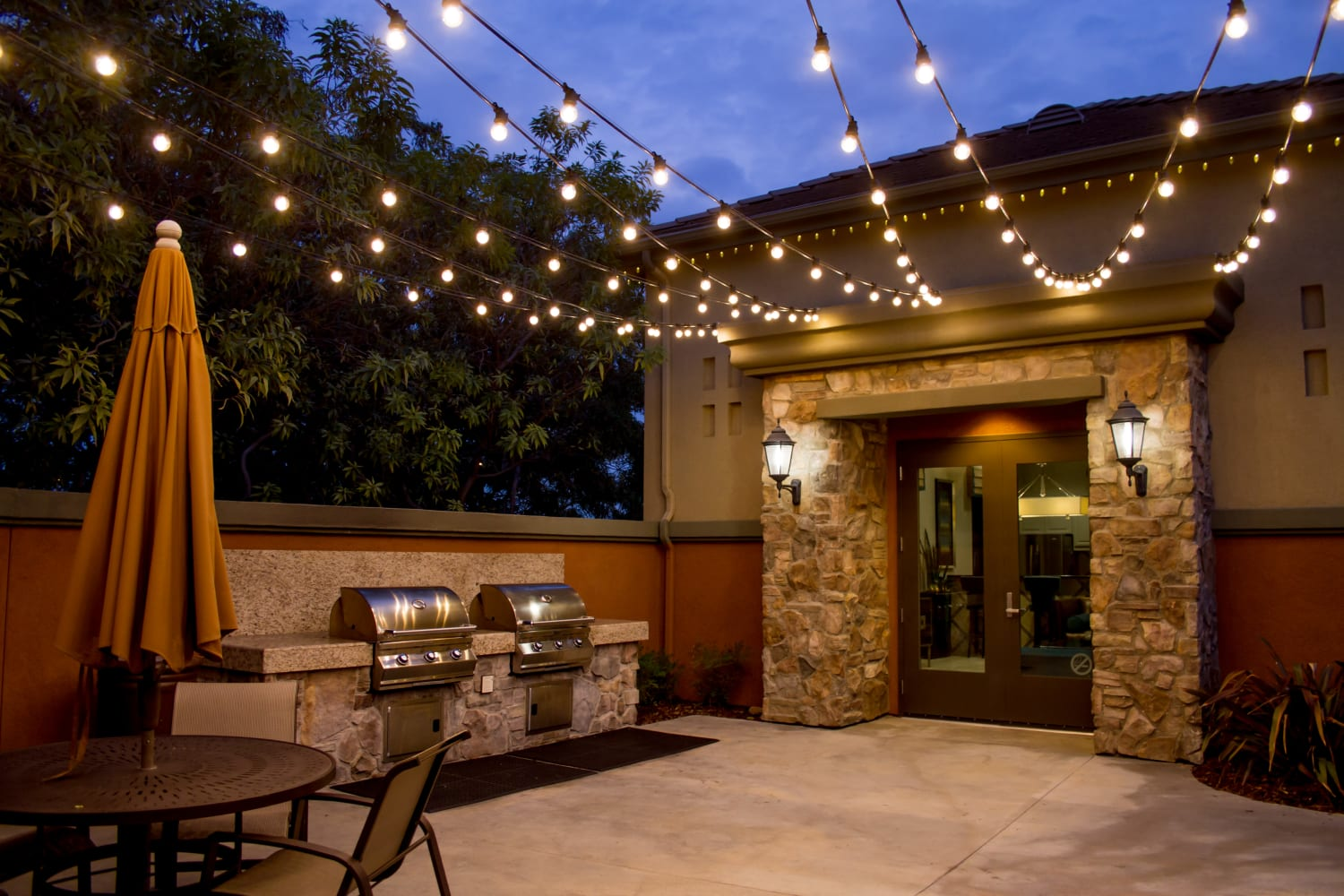 Hanging lights over outdoor community area at Links at Westridge in Valencia, California