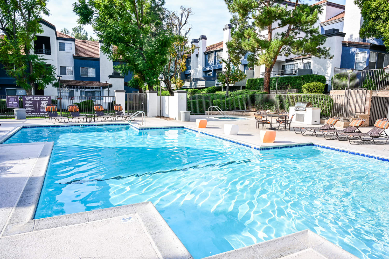 Pool view and beautifully landscaped grounds at Sierra Heights Apartments in Rancho Cucamonga, California