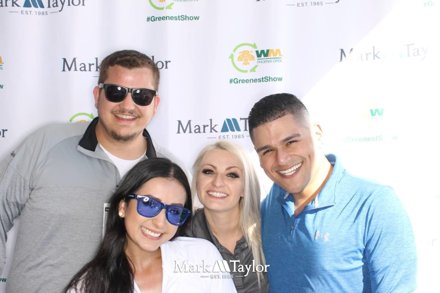 Mark-Taylor employees taking advantage of a photo opportunity at a charity event