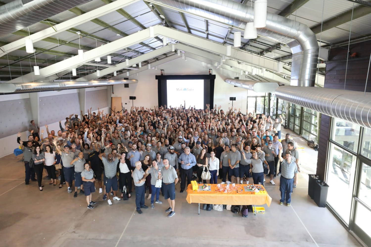 Mark-Taylor employees in a group photo at a large gathering