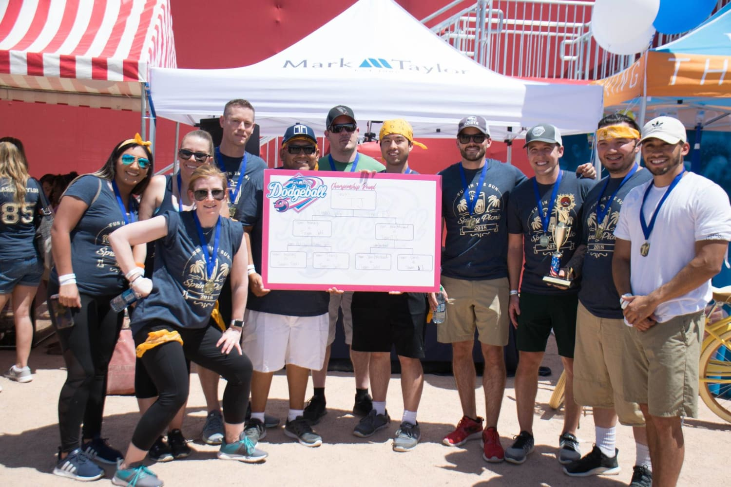 Dodgeball winners posing for a photo at the  company picnic