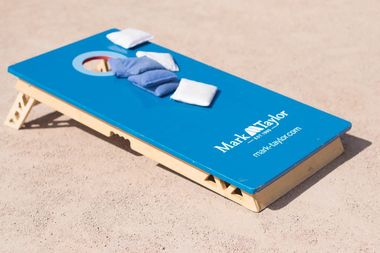 Cornhole board at the Mark-Taylor company picnic