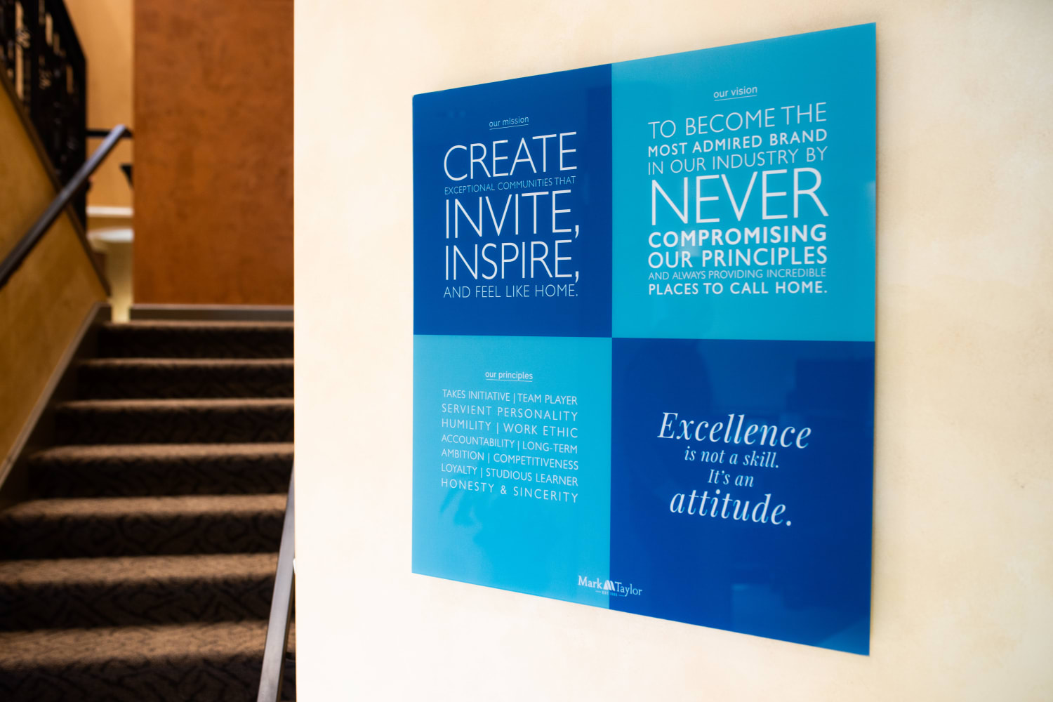 Inspirational quotes on a placard at the Mark-Taylor corporate office