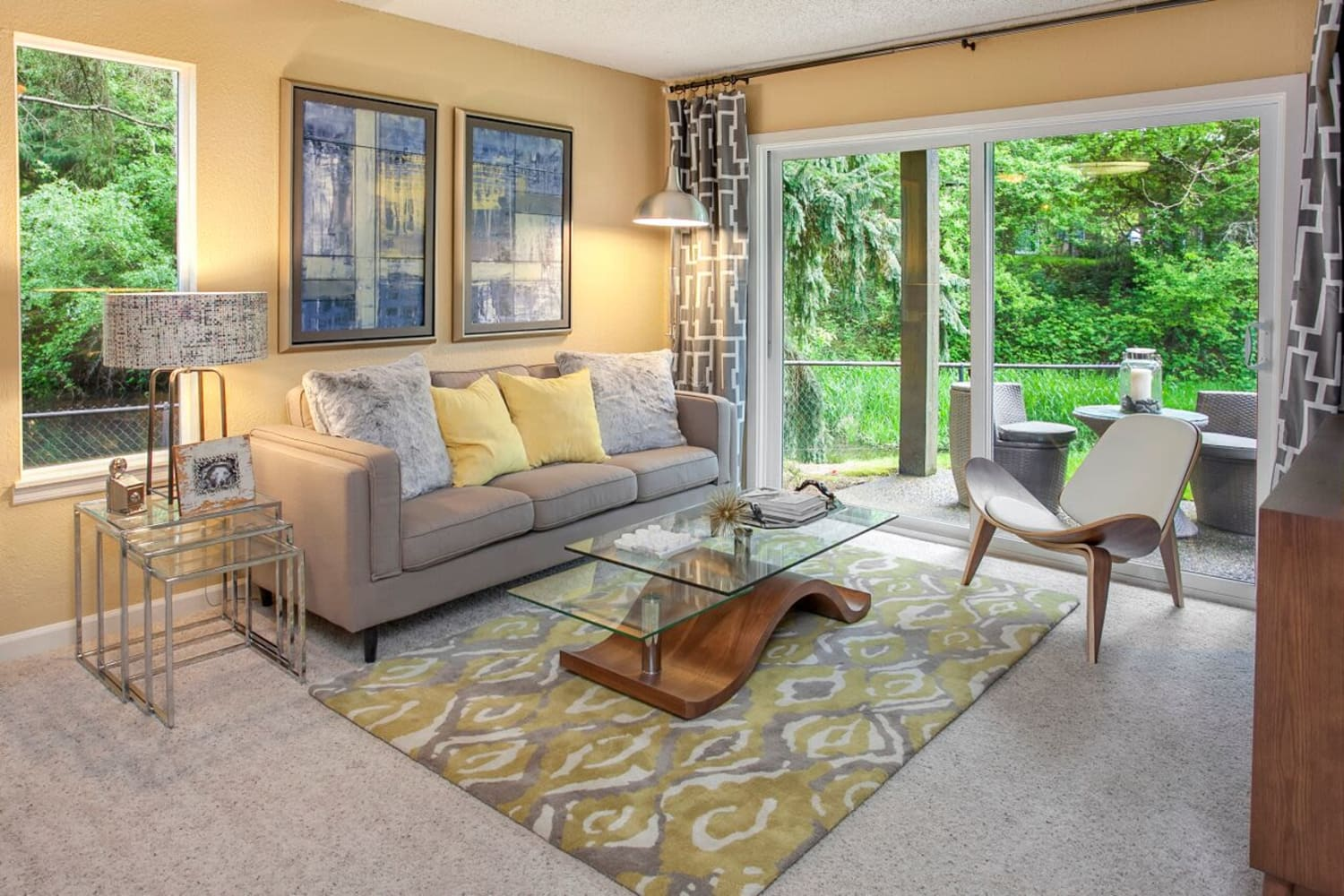 Open living room with lots of windows at The VUE in Kirkland, Washington