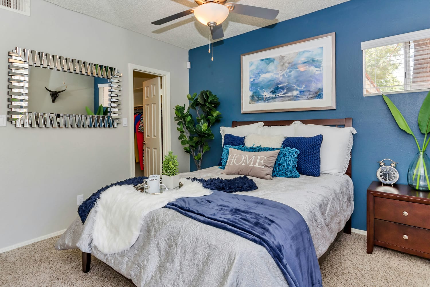 Bedroom with a ceiling fan at Alcove at the Islands in Gilbert, Arizona
