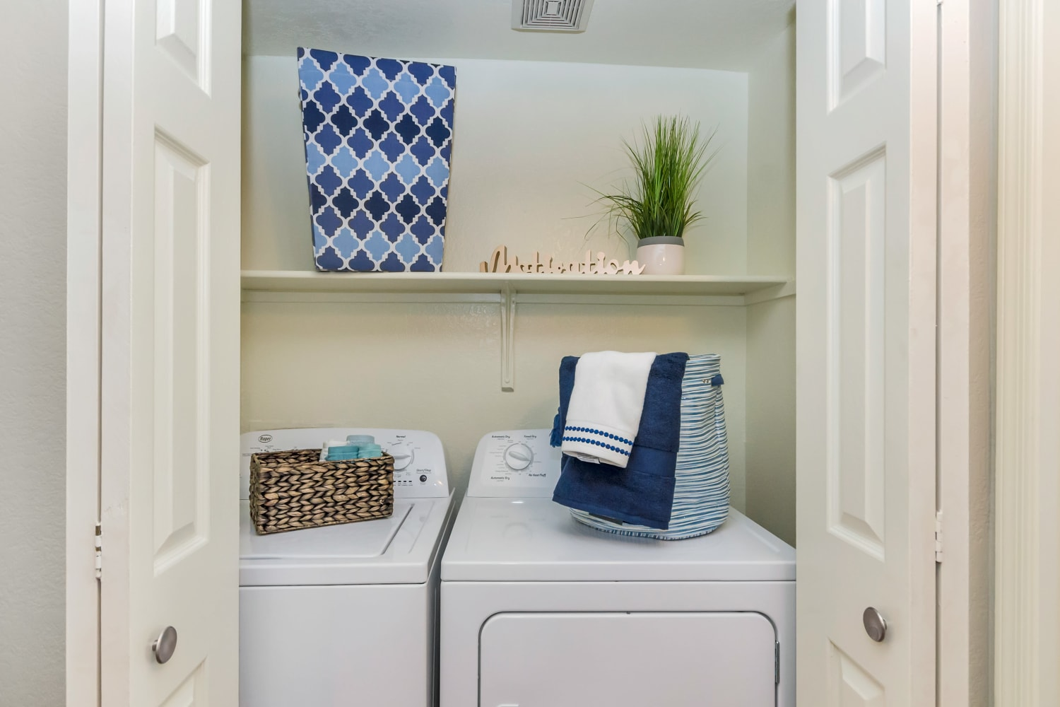 Laundry room with washer and dryer at Alcove at the Islands in Gilbert, Arizona