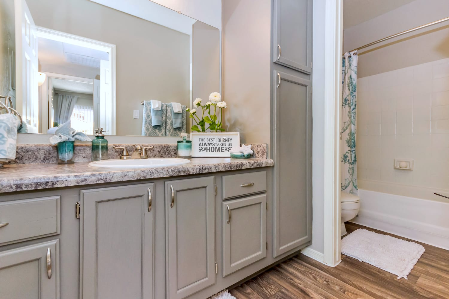 Bathroom with hardwood floors at Alcove at the Islands in Gilbert, Arizona