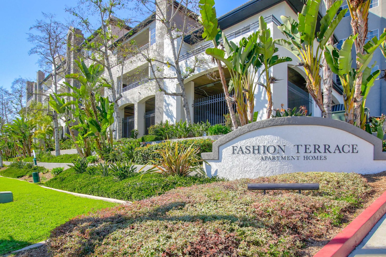 Front entrance sign and manicured grounds at Fashion Terrace in San Diego, California