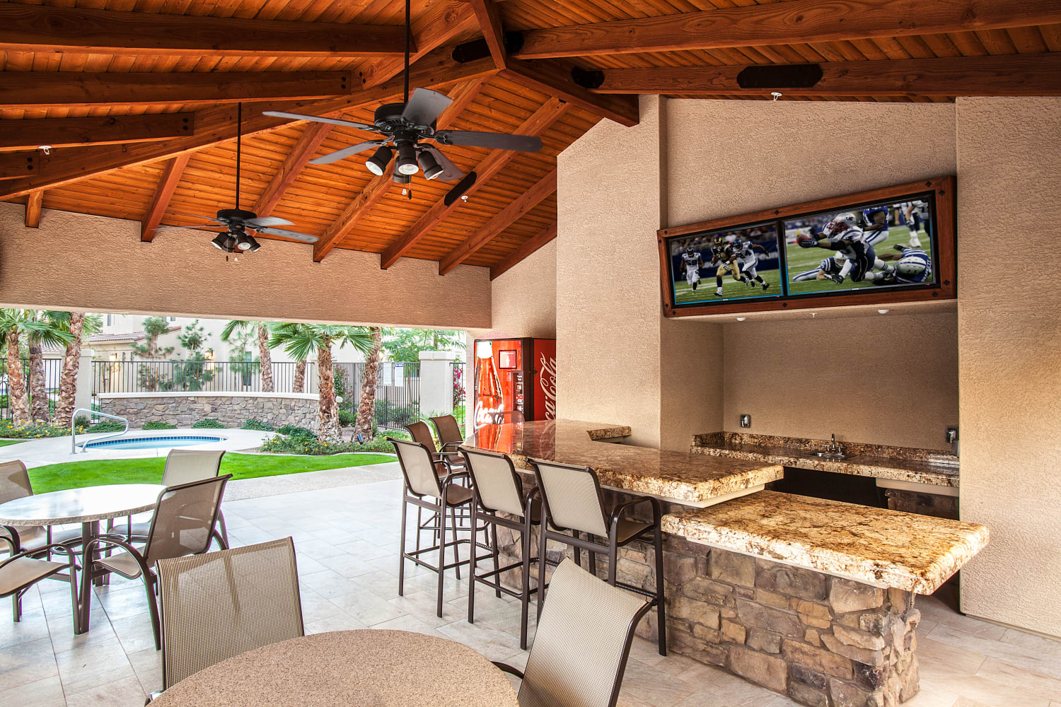 Poolside clubhouse with televisions and kitchen for entertaining at San Marquis in Tempe, Arizona