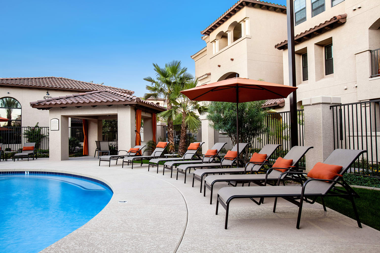 Enjoying sunbathing poolside at San Marquis in Tempe, Arizona
