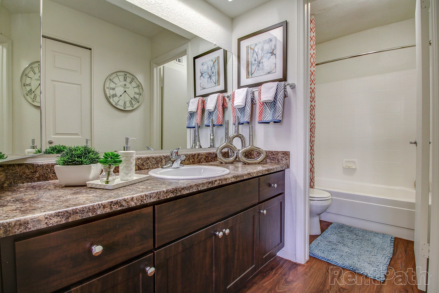 Bathroom with hardwood floors at Casa Santa Fe Apartments in Scottsdale, Arizona