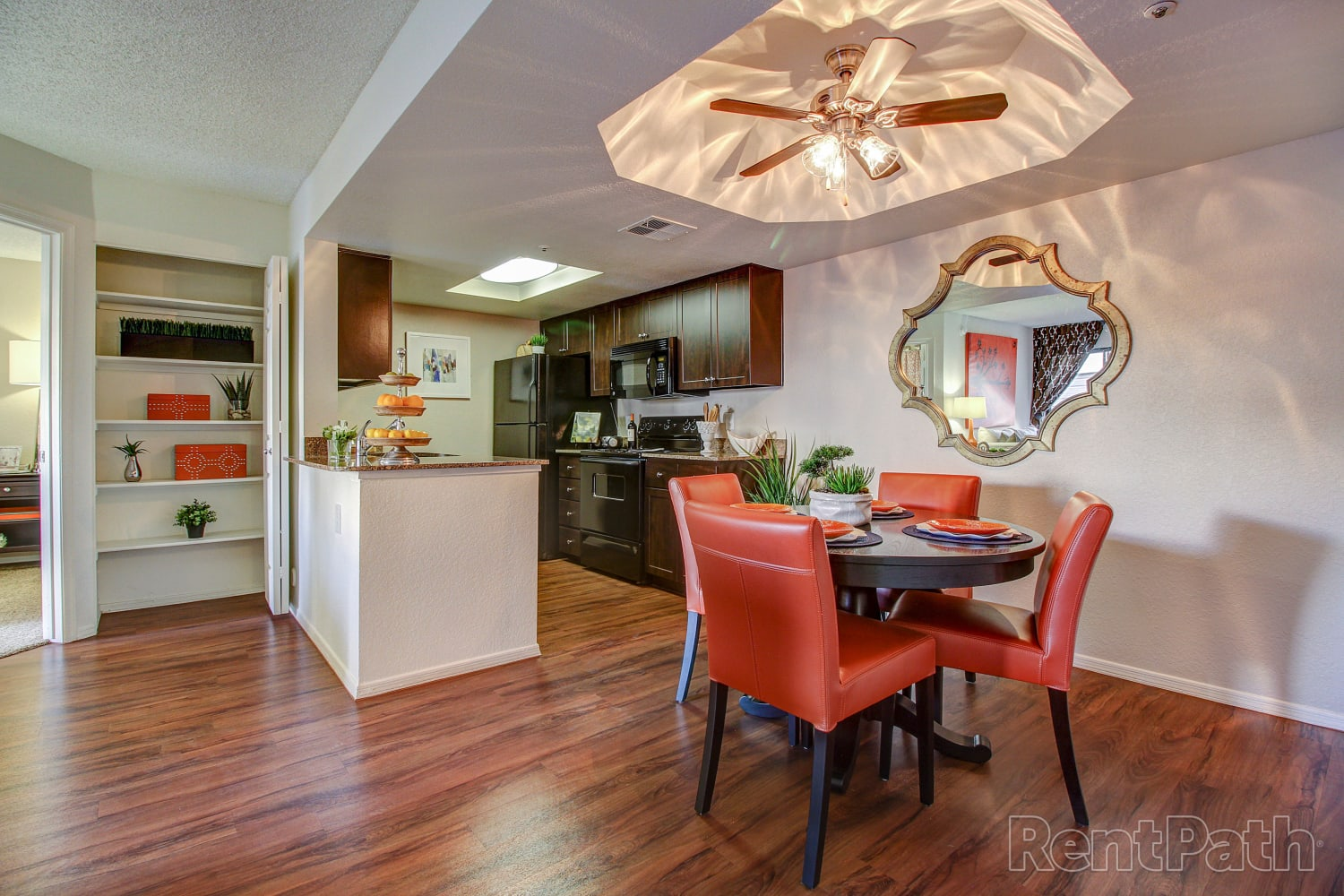 Dinning room with hardwood floors and a ceiling fan at Casa Santa Fe Apartments in Scottsdale, Arizona