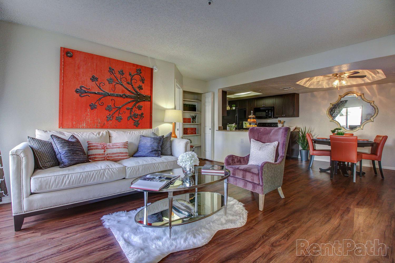 Spacious living room with hardwood floors at Casa Santa Fe Apartments in Scottsdale, Arizona
