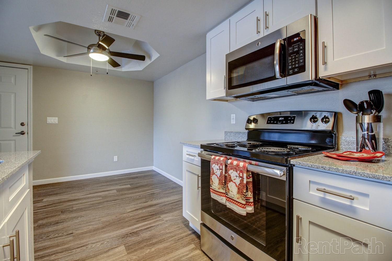 Kitchen with hardwood flooring at Casa Santa Fe Apartments in Scottsdale, Arizona