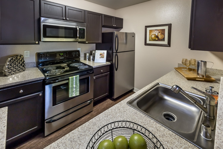 Modern kitchens with stainless steel appliances at Bridges at San Ramon in San Ramon, California