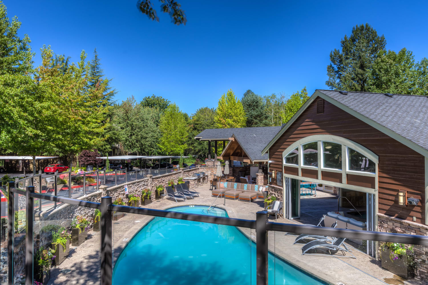 The bright blue outdoor pool at The Preserve at Forbes Creek in Kirkland, Washington