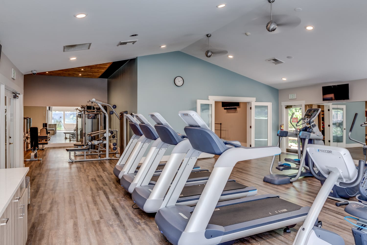 A fully equipped fitness center at The Preserve at Forbes Creek in Kirkland, Washington