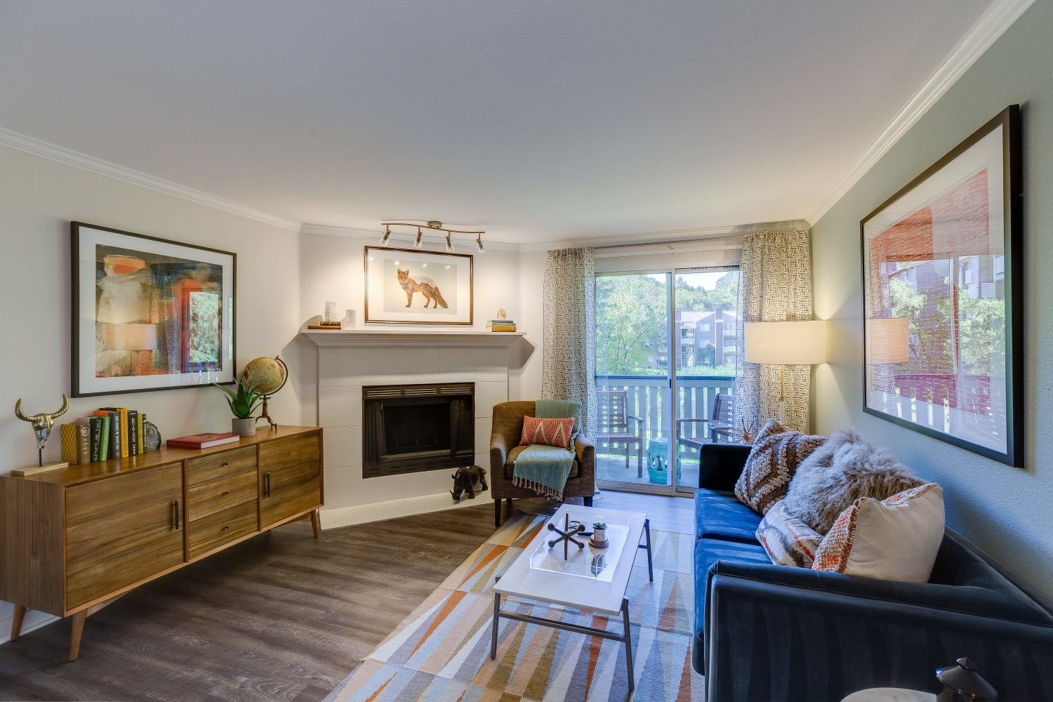 Spacious living room with fireplace and wood floors at The Preserve at Forbes Creek in Kirkland, Washington