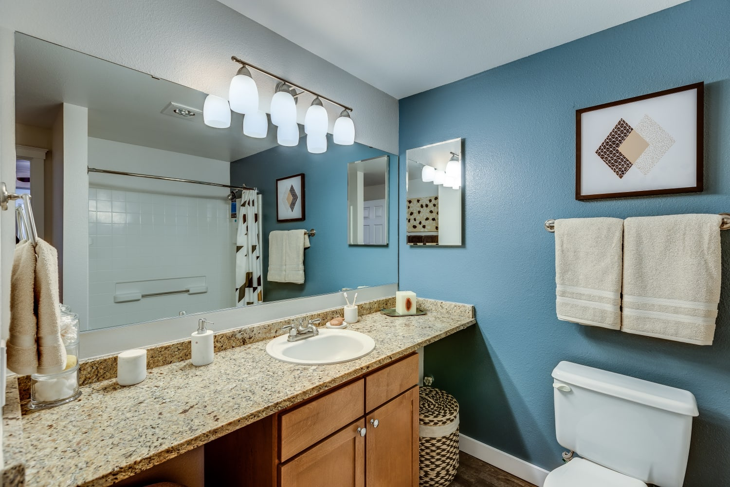 Bright bathroom with huge counters at The Preserve at Forbes Creek in Kirkland, Washington