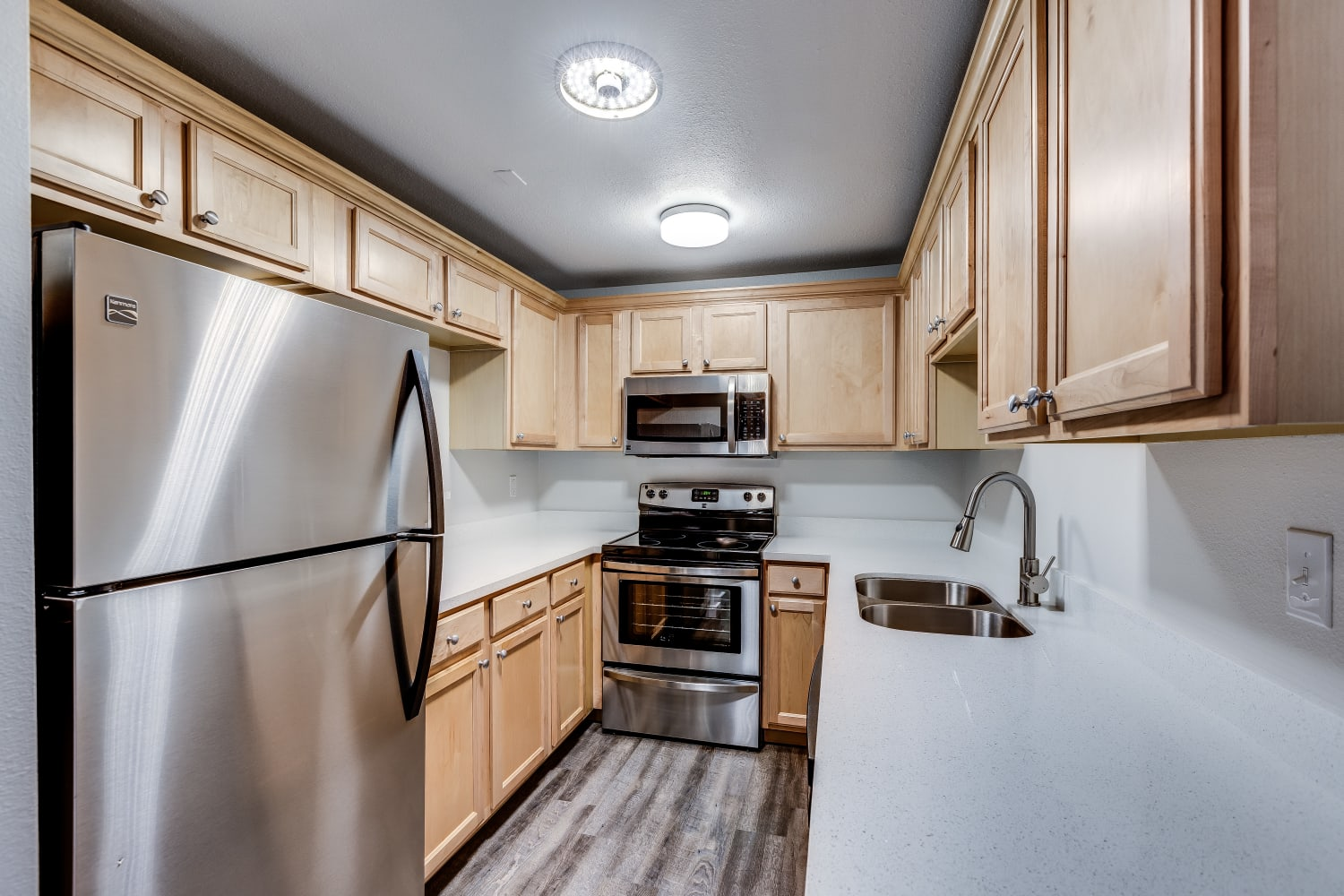Updated kitchen with ample counter space at The Preserve at Forbes Creek in Kirkland, Washington