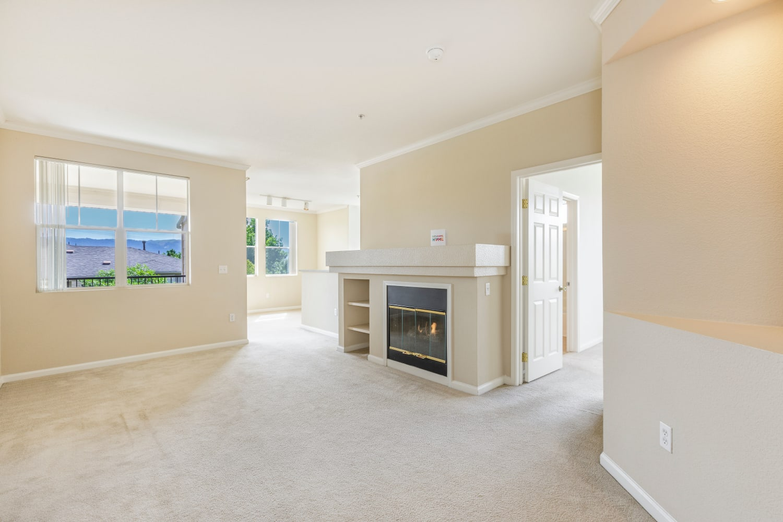 A fireplace in an open floor plan at Park Hacienda Apartments in Pleasanton, California