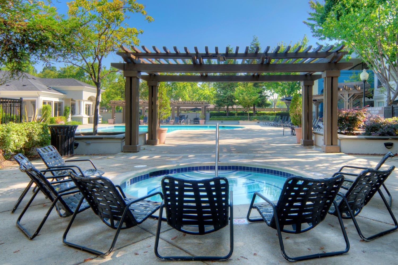 Chairs around the pool area at Park Hacienda Apartments in Pleasanton, California