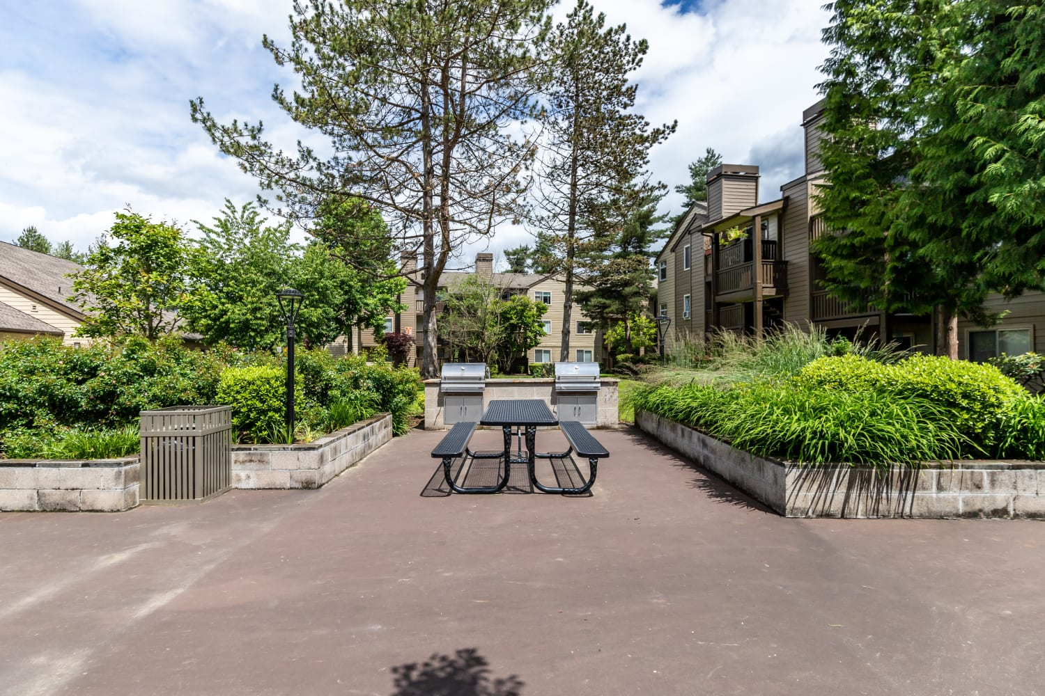 Outdoor community picnic and BBQ space at Campbell Run Apartments in Woodinville, Washington