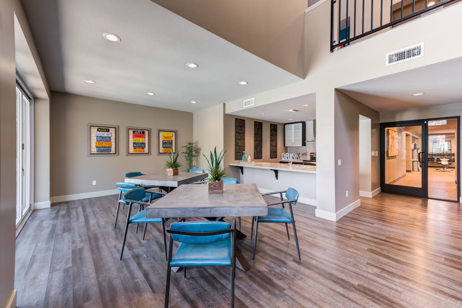 The Spacious clubhouse at Sierra Heights Apartments in Rancho Cucamonga, CA features art on the walls and community gathering space