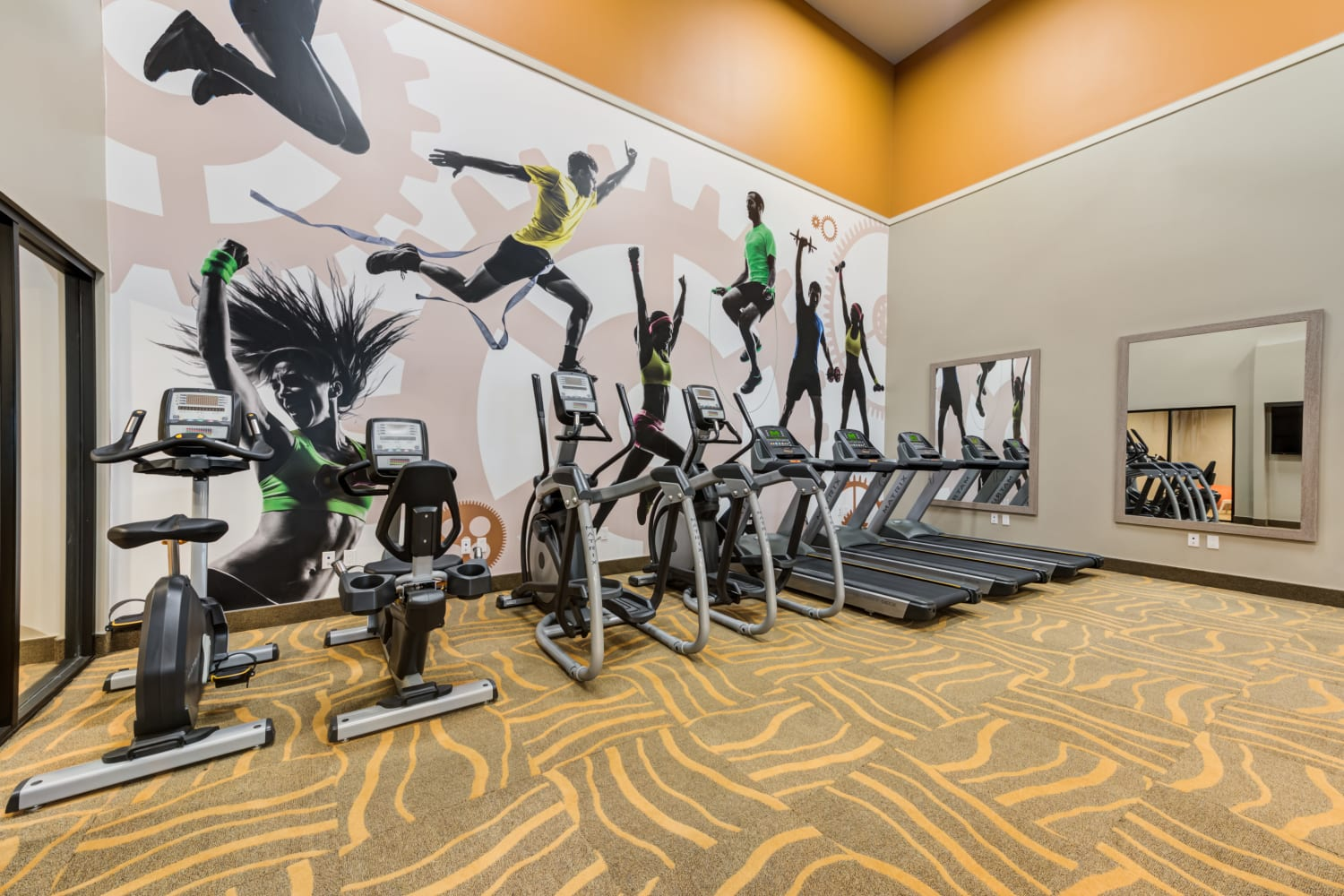 Modern exercise equipment in the fitness center at Sierra Heights Apartments in Rancho Cucamonga, CA