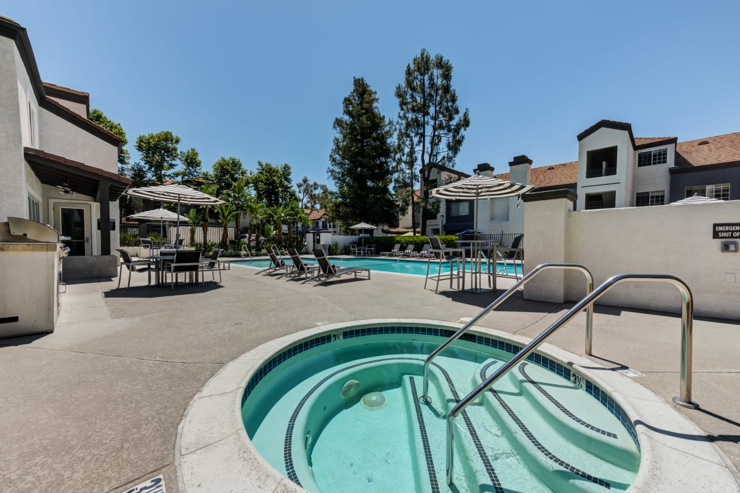 Hot tub sauna by community swimming pool at Sierra Heights Apartments in Rancho Cucamonga, CA