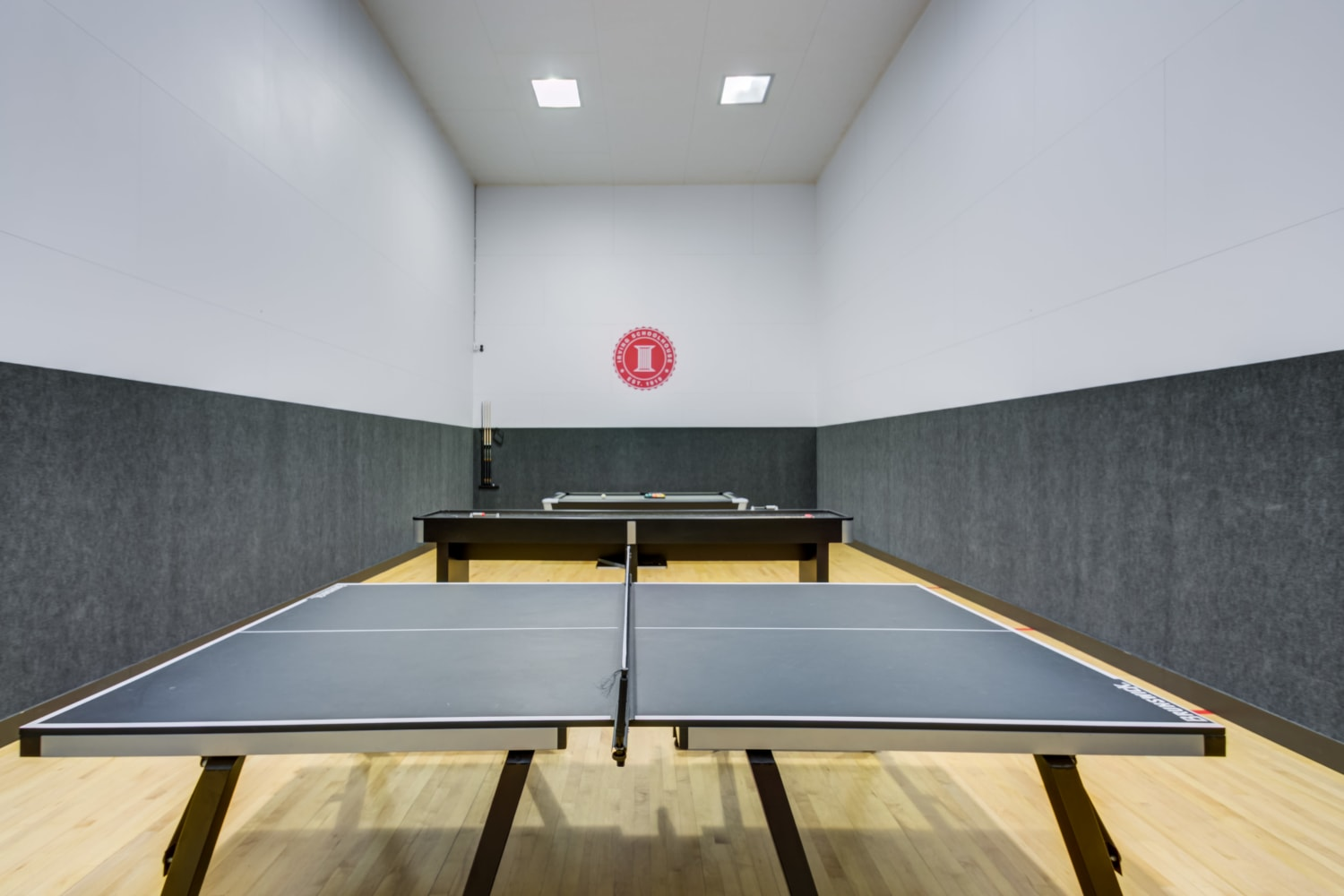 Ping pong table, shuffleboard and billiards table In the game room at Irving Schoolhouse Apartments in Salt Lake City, Utah
