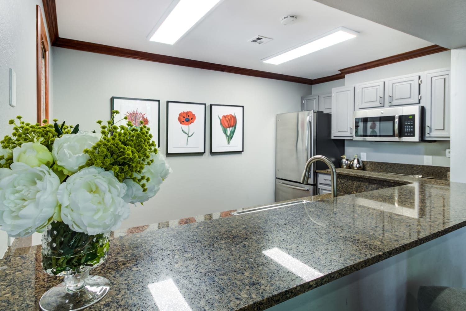 Call breakfast bar seating countertop in a kitchen at Irving Schoolhouse Apartments in Salt Lake City, Utah