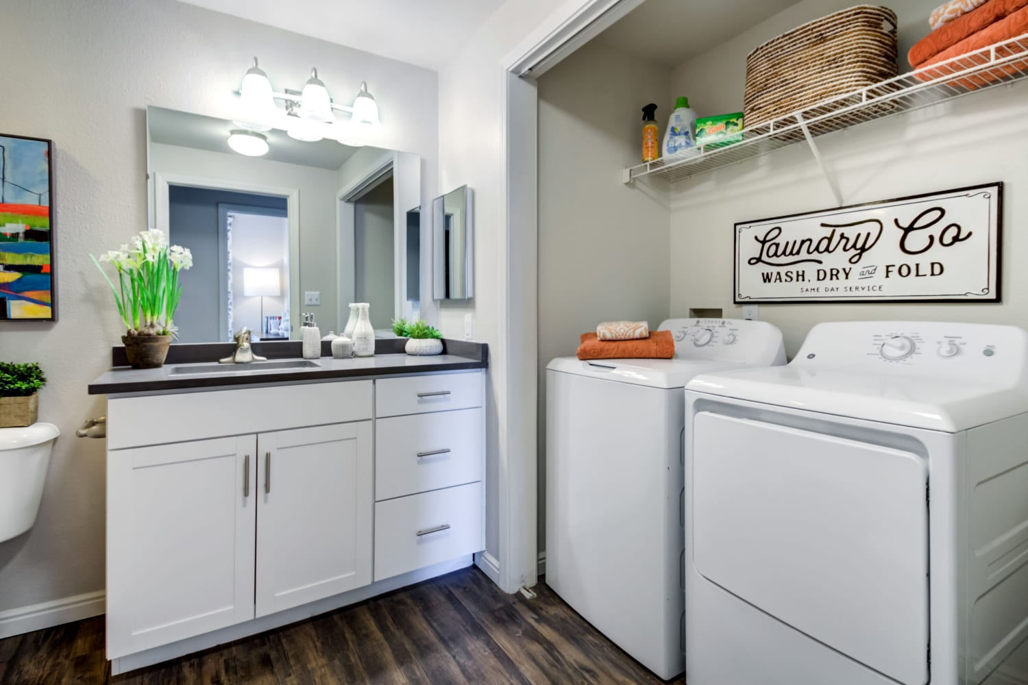 Washer and dryer sharing space inside bathroom in an apartment at Irving Schoolhouse Apartments in Salt Lake City, Utah