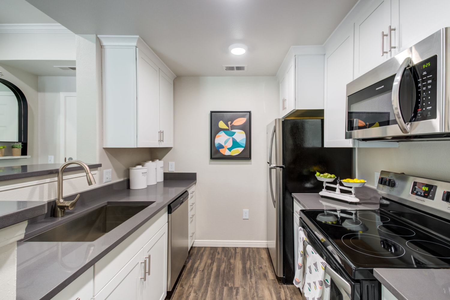 High end appliances and kitchen finishes in an apartment at Irving Schoolhouse Apartments in Salt Lake City, Utah