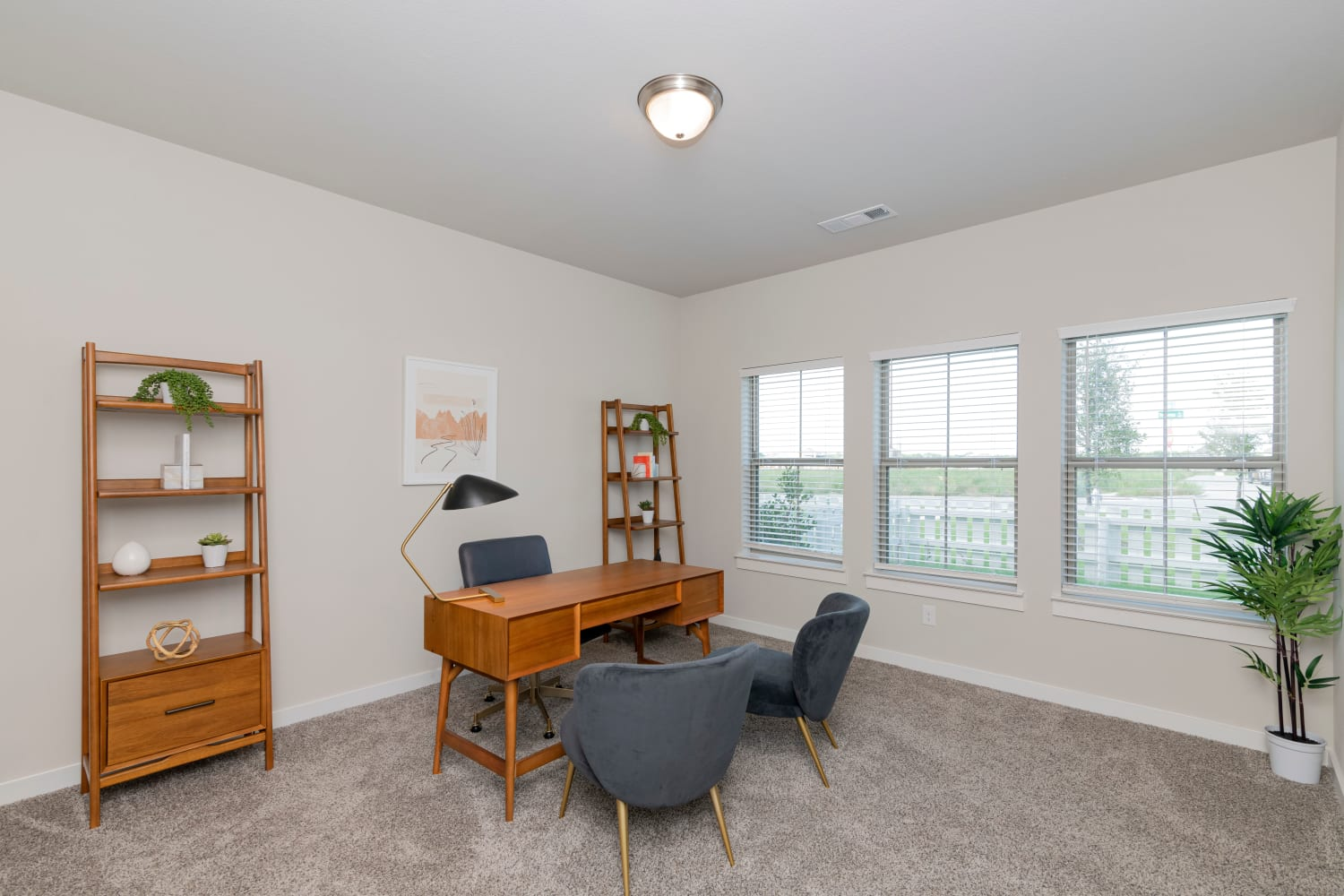 A model unit with a room decorated as an office at Waxahachie, Texas