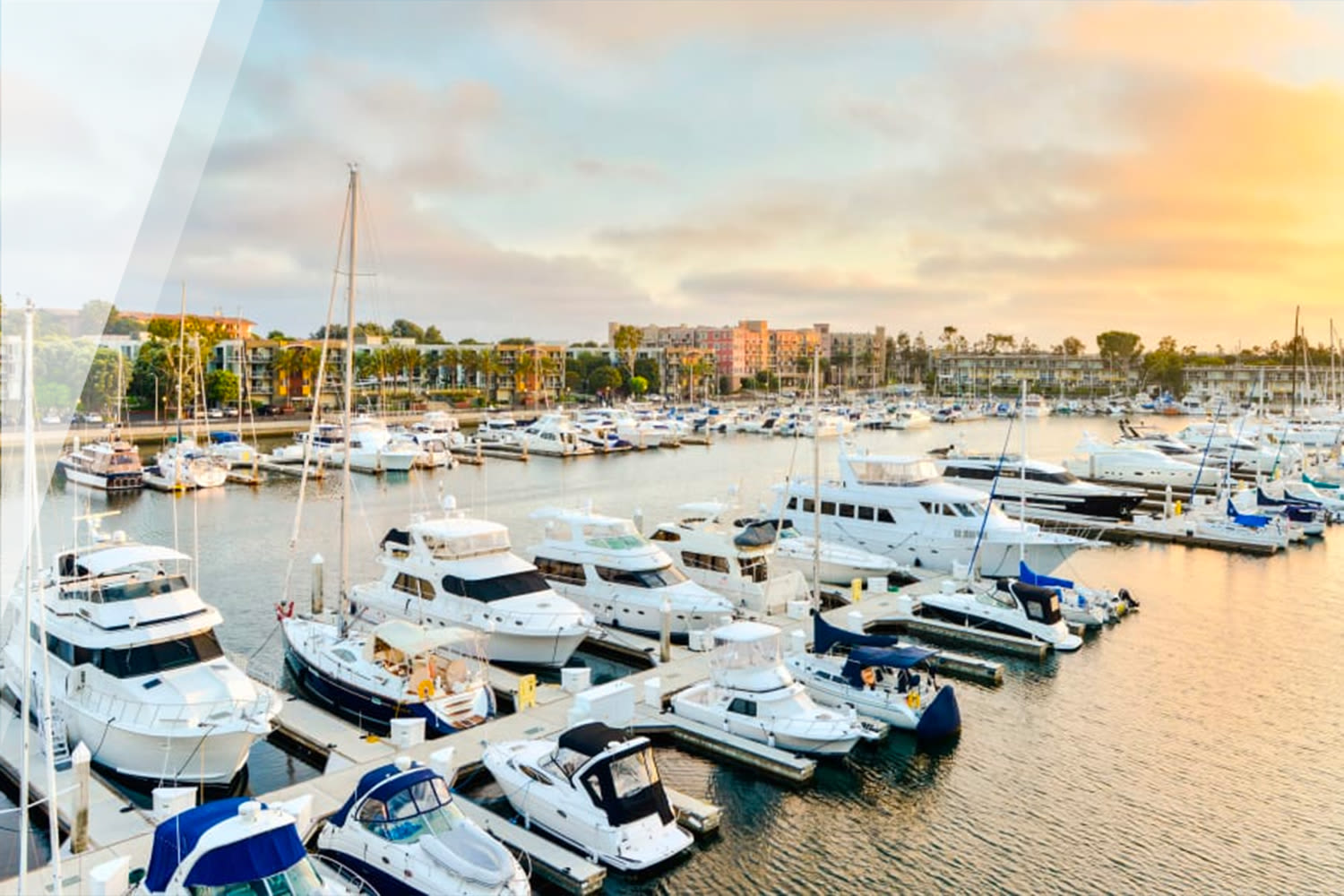 Sunset view of boats in slips at our Marina Harbor property at E&S Ring Management Corporation in Los Angeles, California