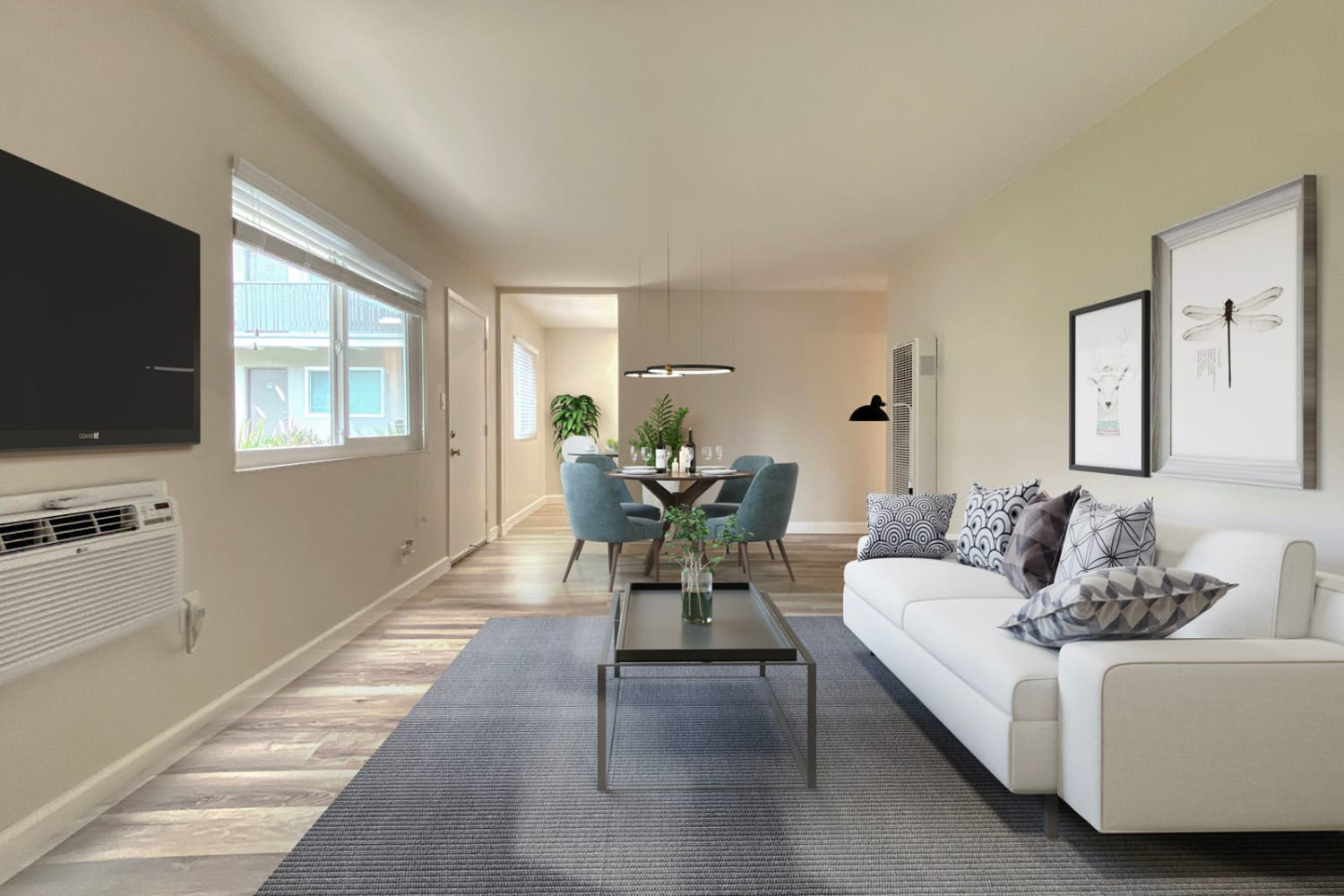 Modern furnishings and large bay windows in a model apartment's open-concept living space at Pleasanton Heights in Pleasanton, California