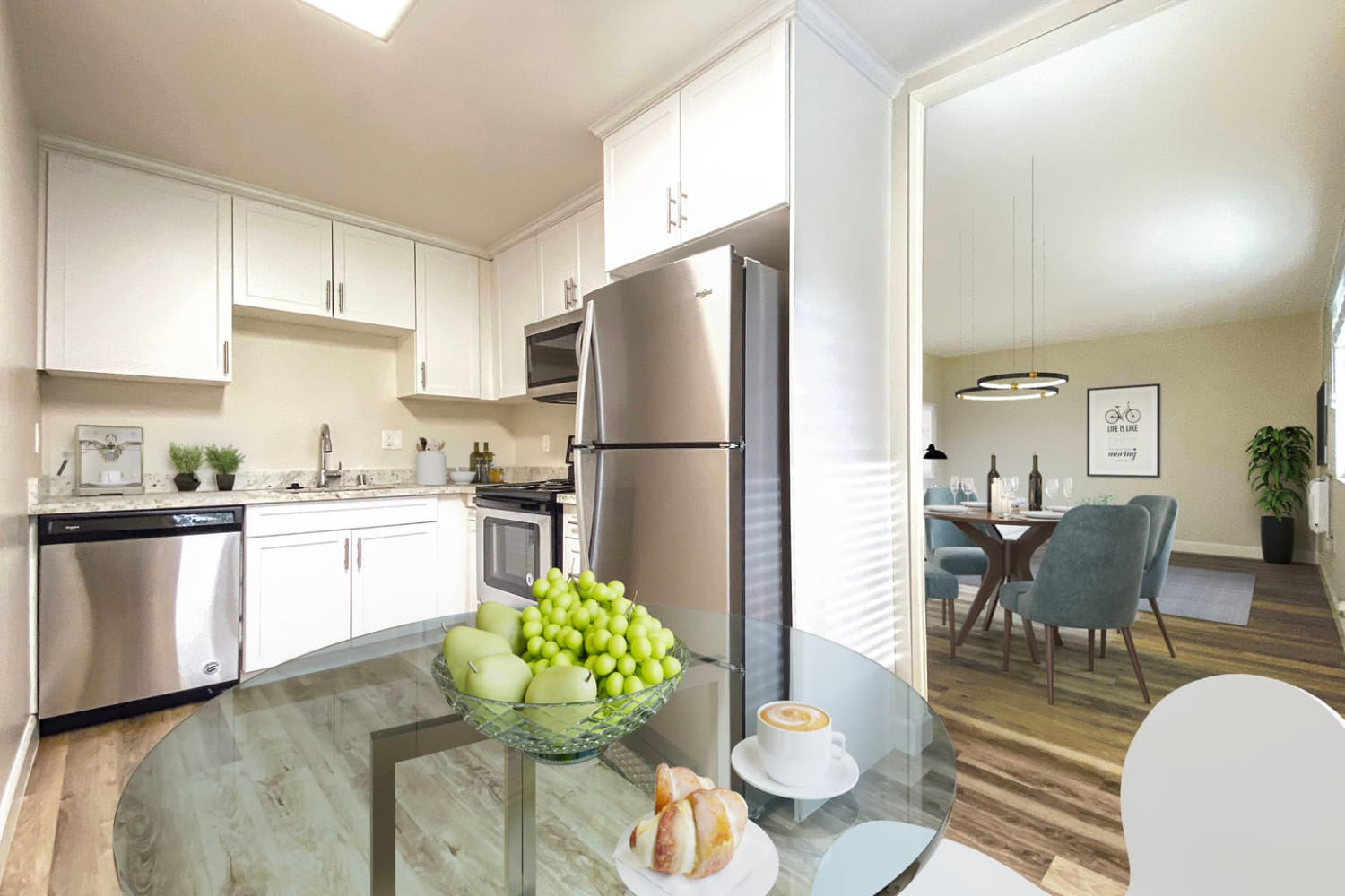 Bright white cabinetry and stainless-steel appliances in a model home's kitchen at Pleasanton Heights in Pleasanton, California