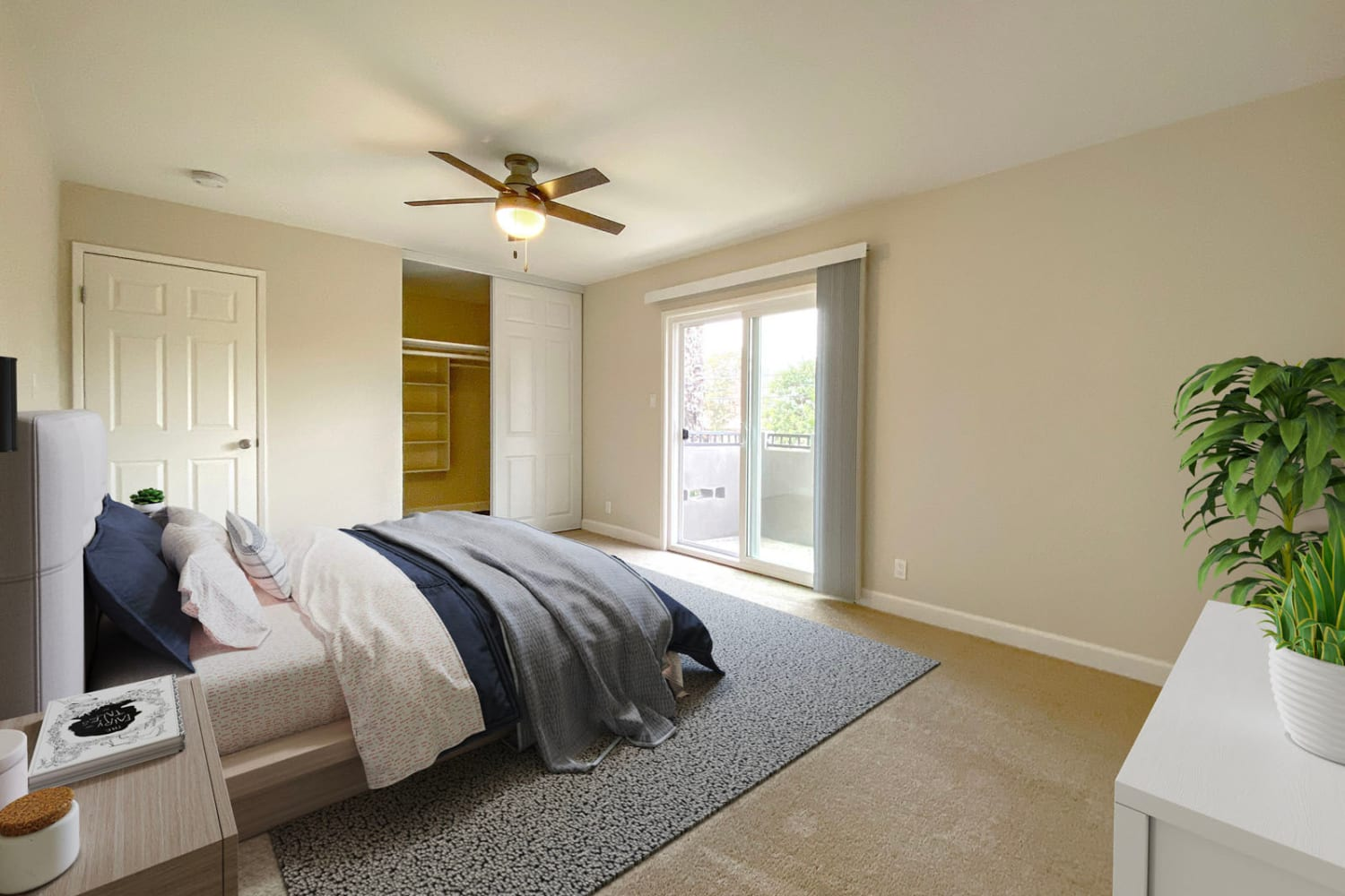 Plush carpeting and a ceiling fan in a model apartment's bedroom at Pleasanton Heights in Pleasanton, California