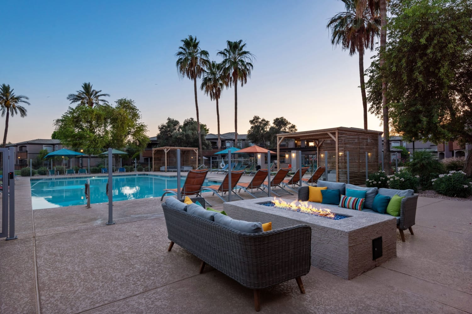 Poolside seating by the firepit at Luxe @ Ocotillo in Chandler, Arizona