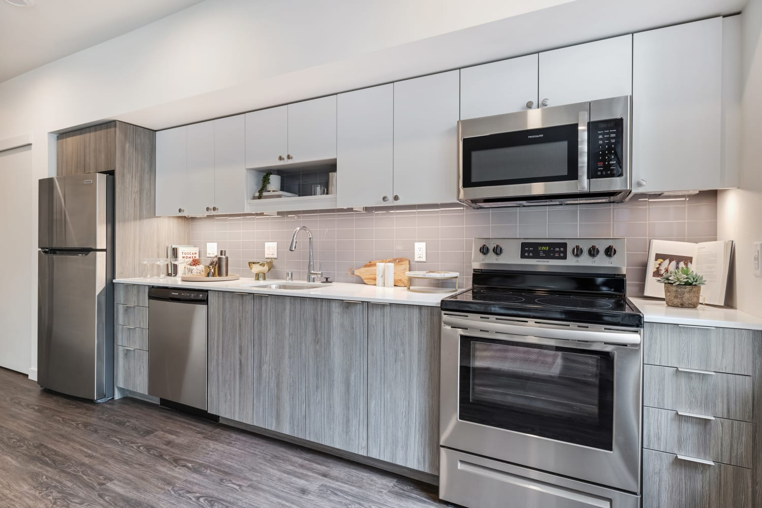 Model kitchen with stainless-steel appliances and chef's island at Nightingale in Redmond, Washington