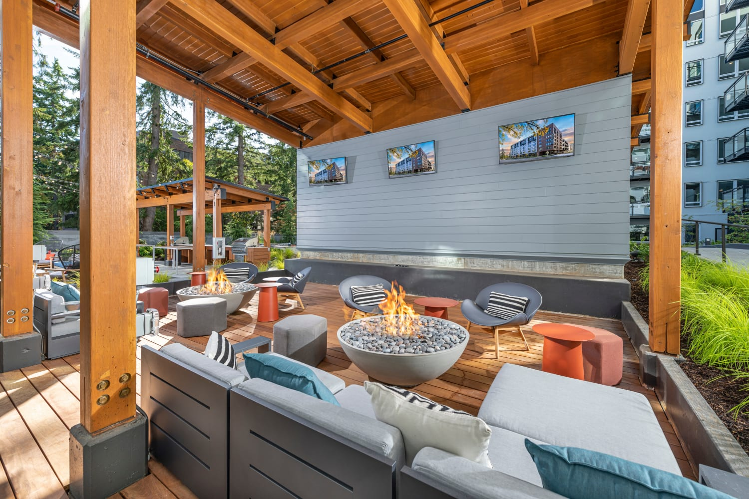 Outdoor lounge with TVs at Nightingale in Redmond, Washington
